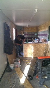 Tommy working hard refurbishing the converted shipping container ready for re-opening before Christmas